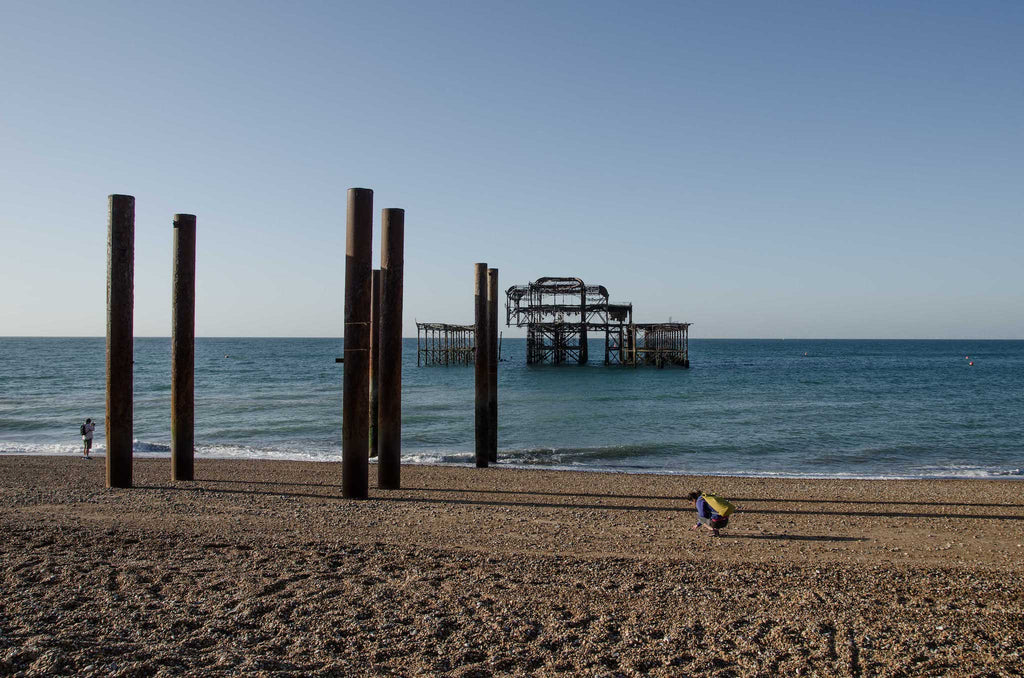 A clear day on Brighton beach, West Pier in the background