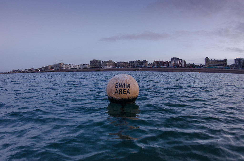 Buoy marked Swim Area off Brighton shore, Brighton in background