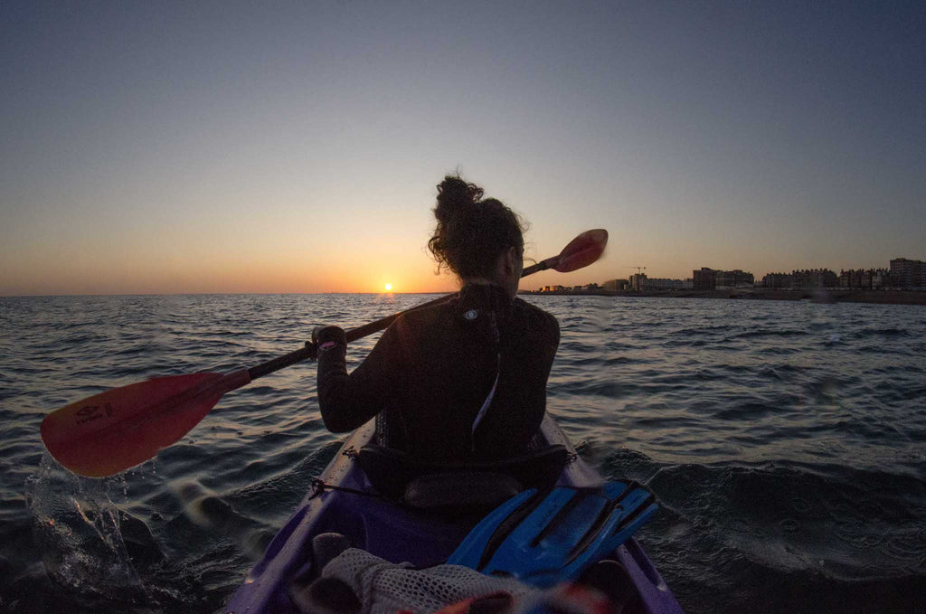 Kayaking at sunset towards Brighton