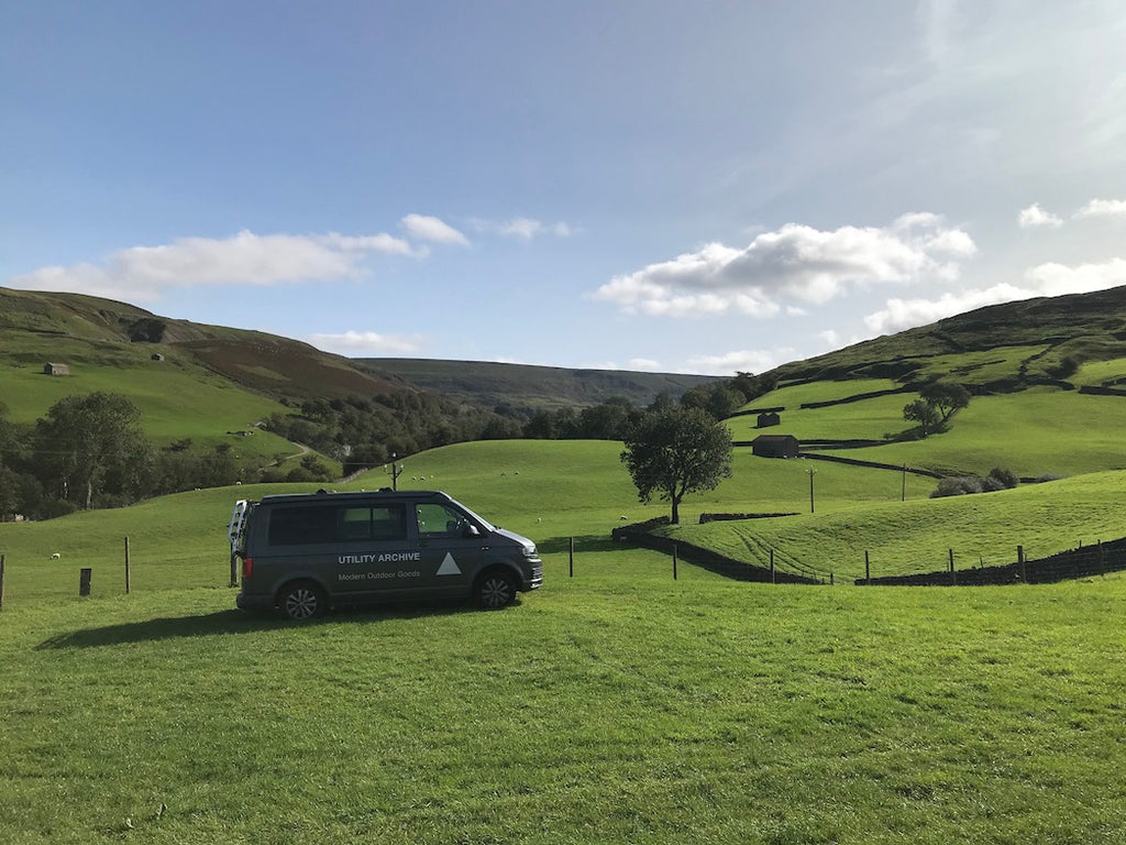 View down green valley with Utility Archive VW T6 campervan