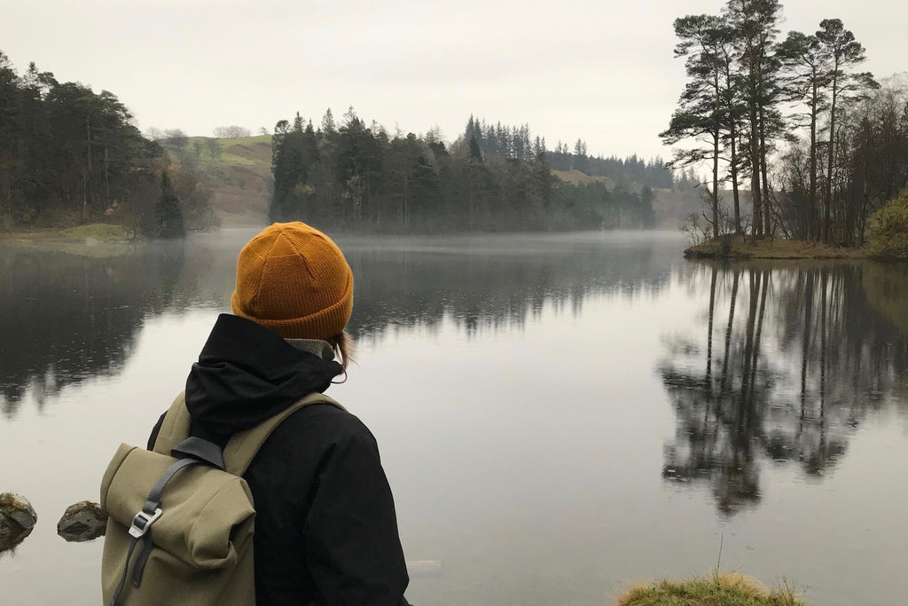 Woman hiker admiring view over Tarn Hows