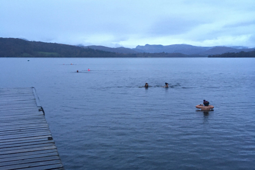 Swimmers in Windermere Lake at dawn