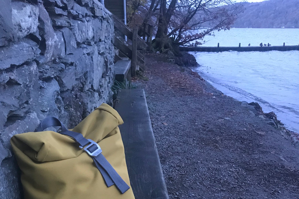 Yellow backpack by Windermere lake
