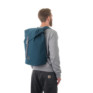 Man carrying blue flap backpack.