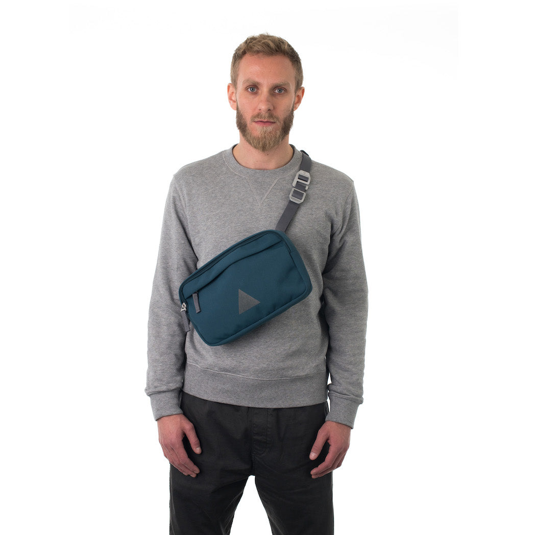 Man wearing blue cross body bag.