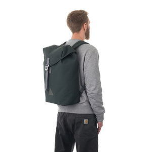 Man carrying grey flap backpack.