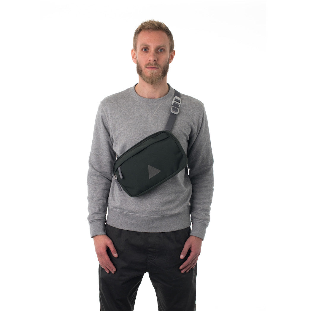 Man wearing grey cross body bag.