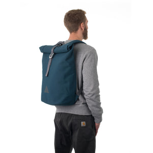 Man carrying blue rolltop backpack.