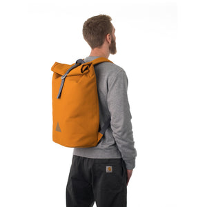 Man carrying orange rolltop backpack.