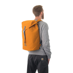Man carrying orange flap backpack.