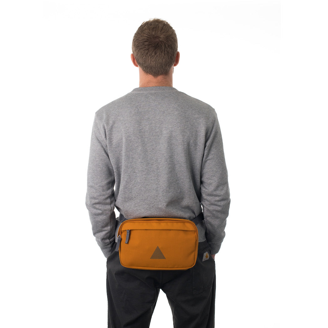 Man wearing orange bumbag.