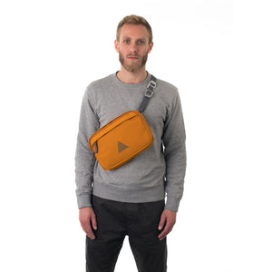 Man wearing orange cross body bag.