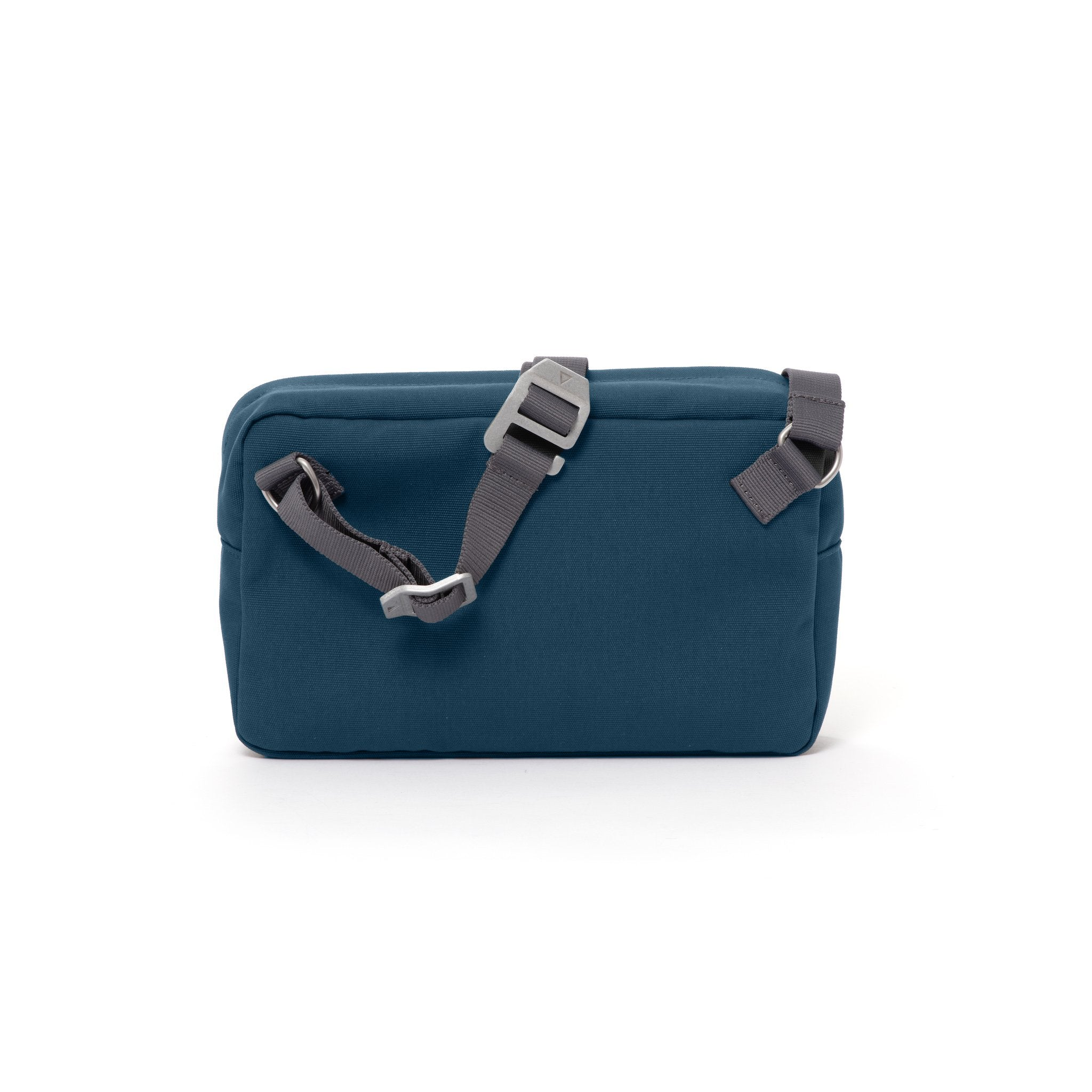 Blue shoulder bag with webbing strap and aluminium buckles.