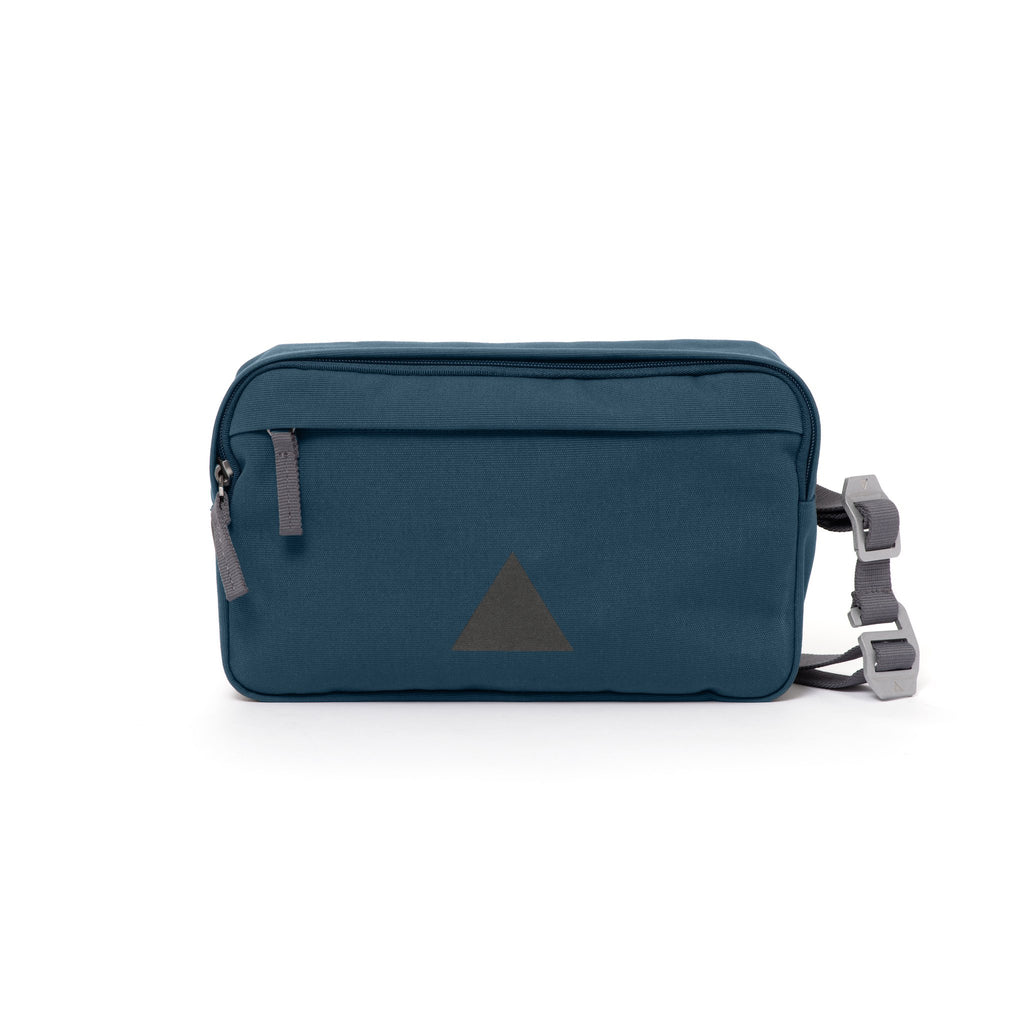 Blue Grey canvas shoulder bag with front zip pocket, webbing strap and aluminium buckles.