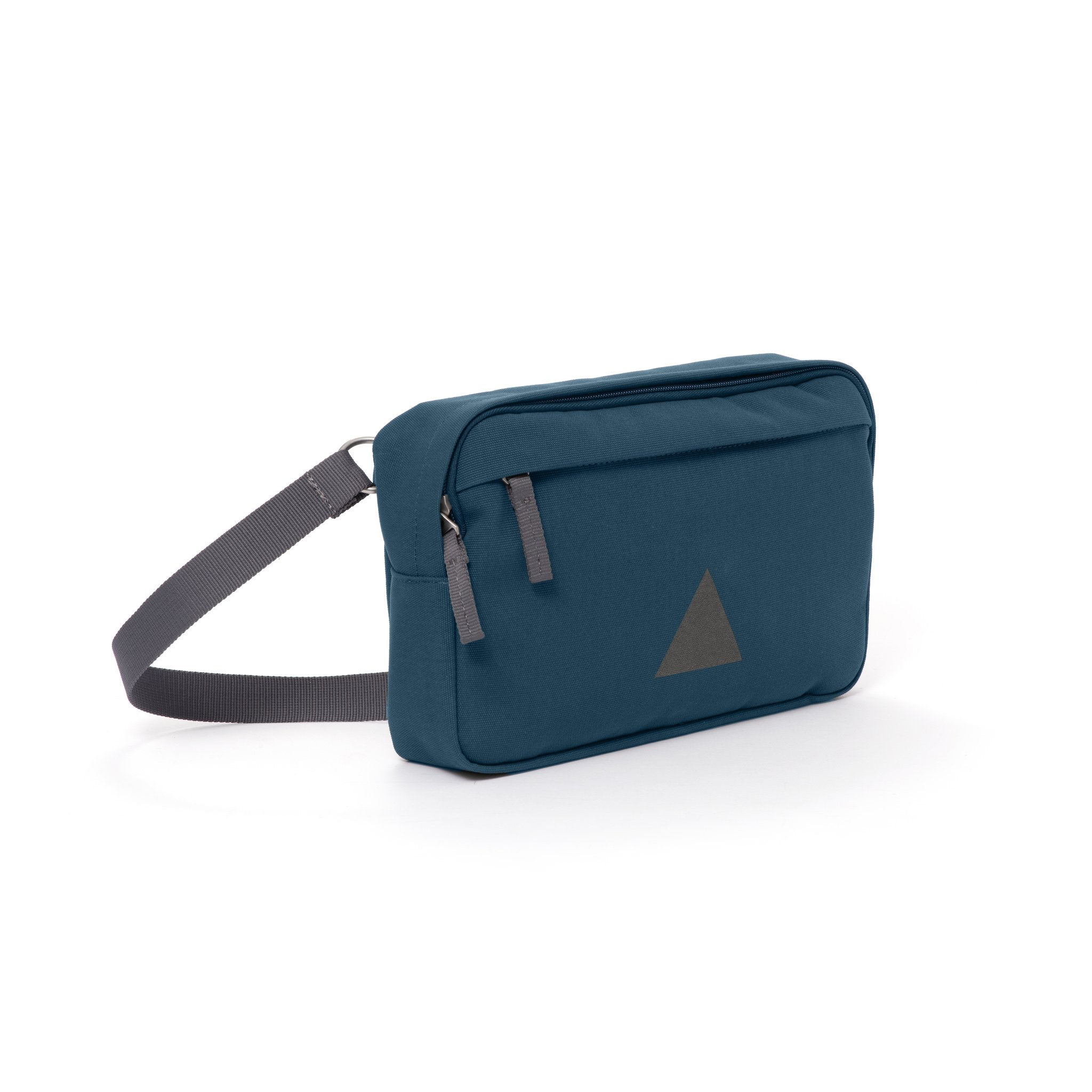 Blue canvas shoulder bag with zip pockets and webbing strap.