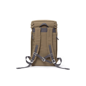 Khaki canvas backpack with padded shoulder straps and chest strap.