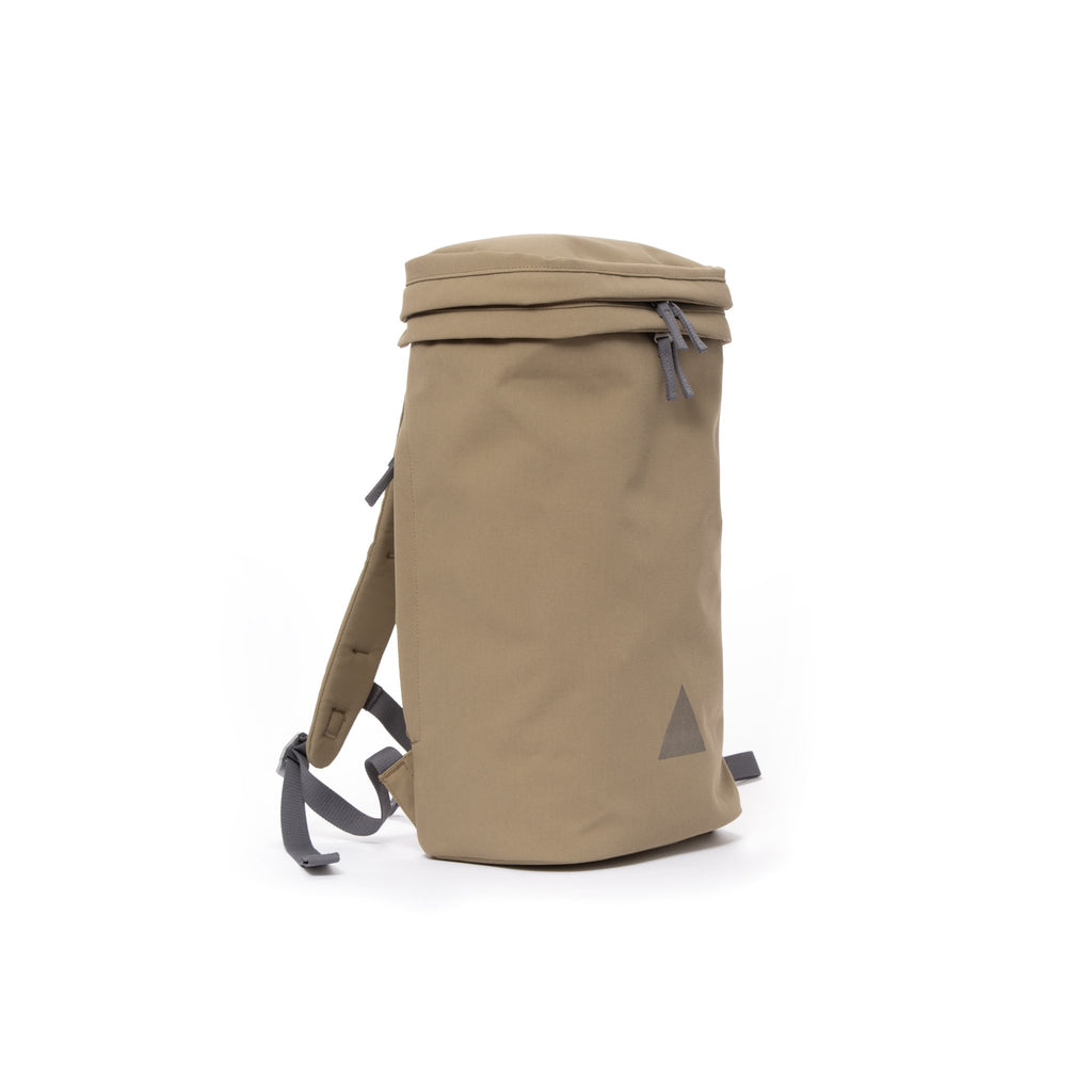 Khaki canvas backpack with padded shoulder straps and triangle logo.