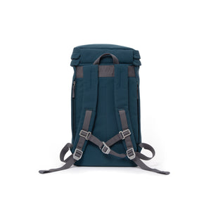 Blue canvas backpack with padded shoulder straps and chest strap.