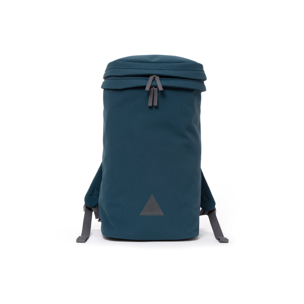 Blue canvas backpack with zip opening, padded shoulder straps and triangle logo.