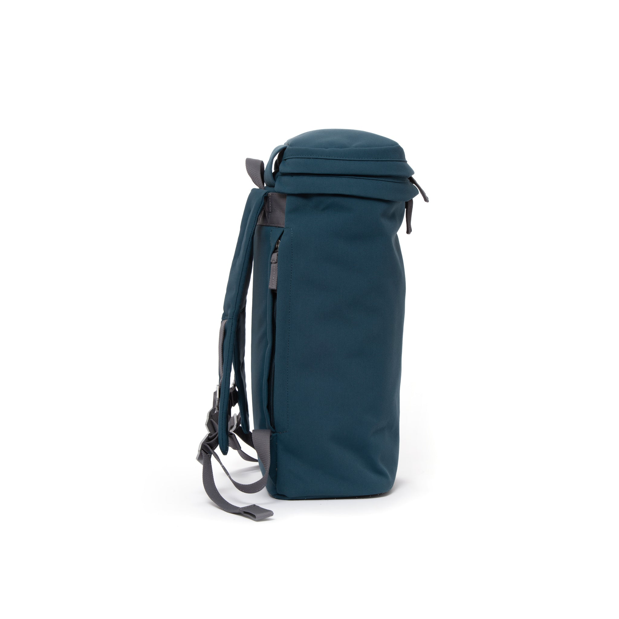 Blue canvas backpack with top zip pocket.