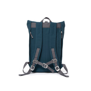 Blue rolltop backpack with padded shoulder straps and chest strap.