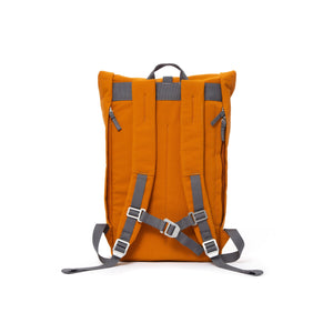 Orange rolltop backpack with padded shoulder straps and chest strap.