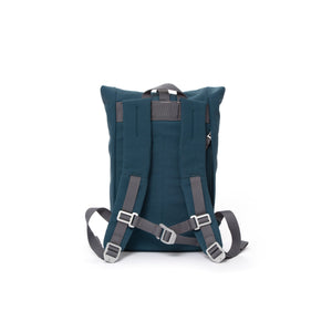 Blue small rolltop backpack with padded shoulder straps and chest strap.