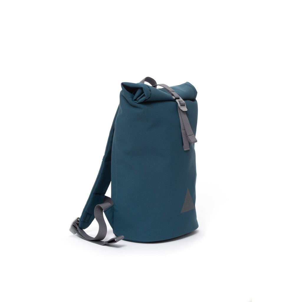 Blue recycled canvas women's rolltop backpack.