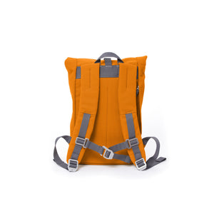 Orange small rolltop backpack with padded shoulder straps and chest strap.