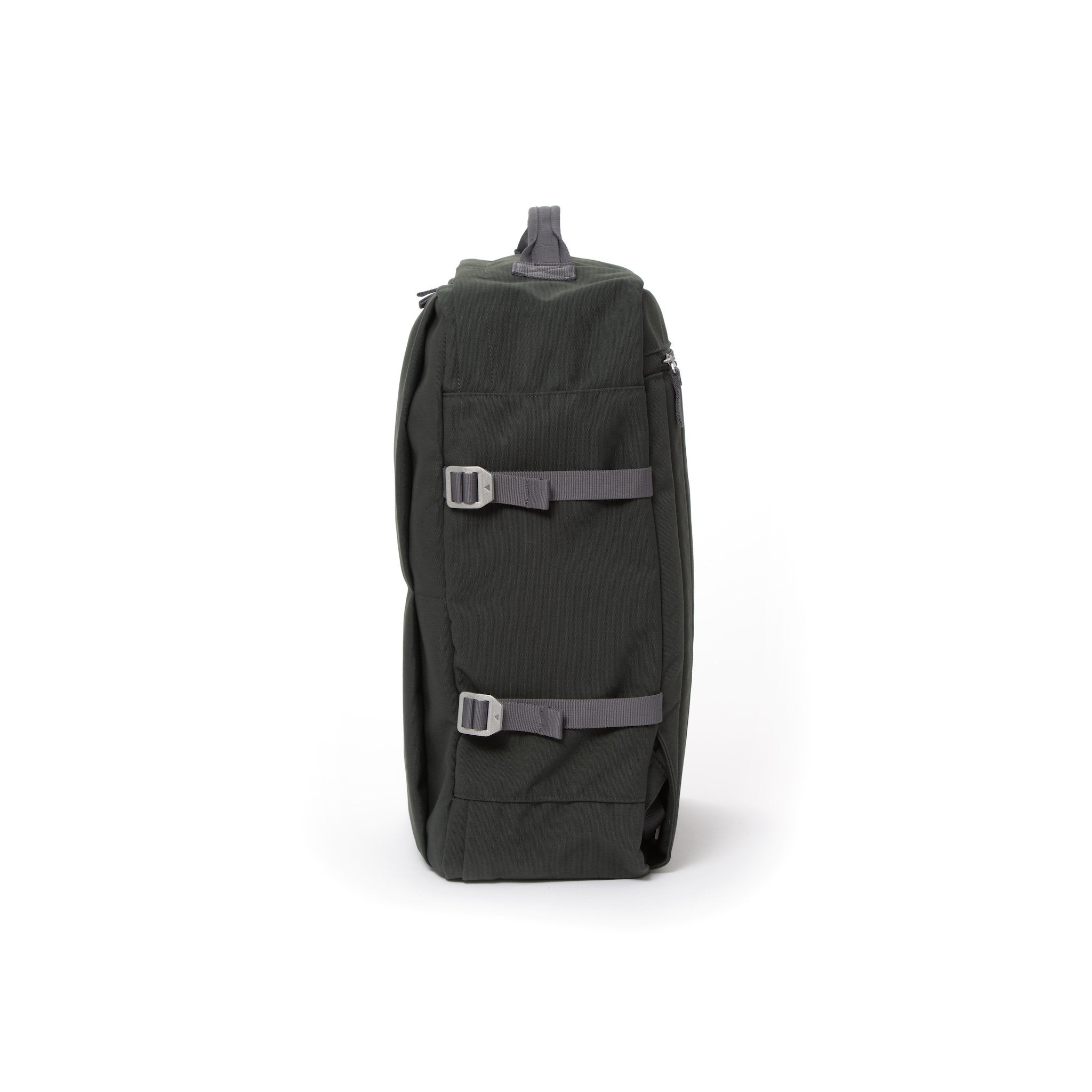 Grey waterproof canvas travel backpack with compression side straps.