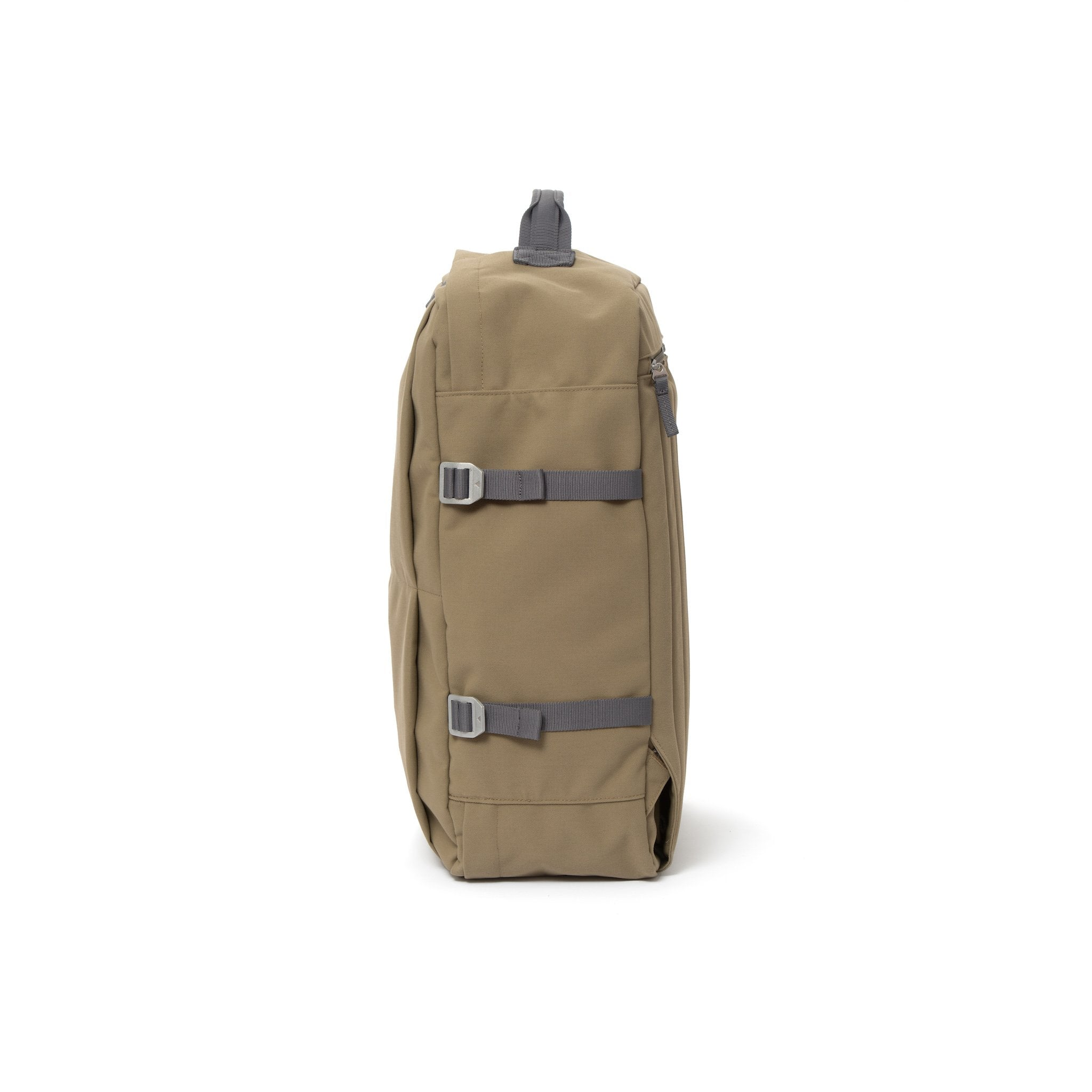 Khaki waterproof canvas travel backpack with compression side straps.