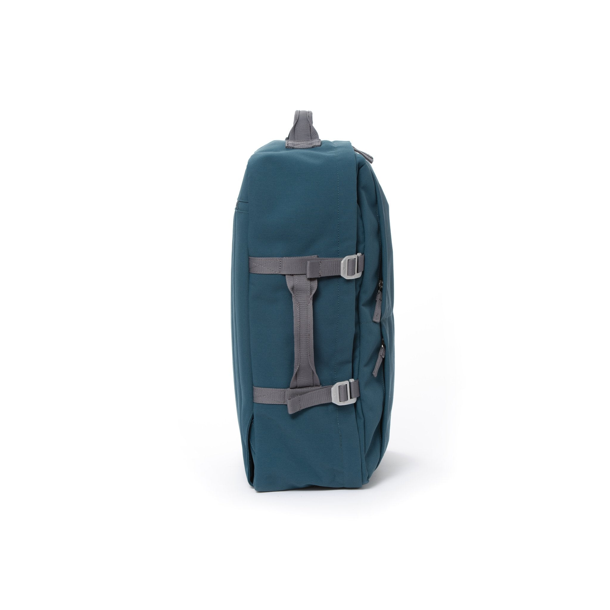 Blue recycled canvas travel backpack with compression side straps.
