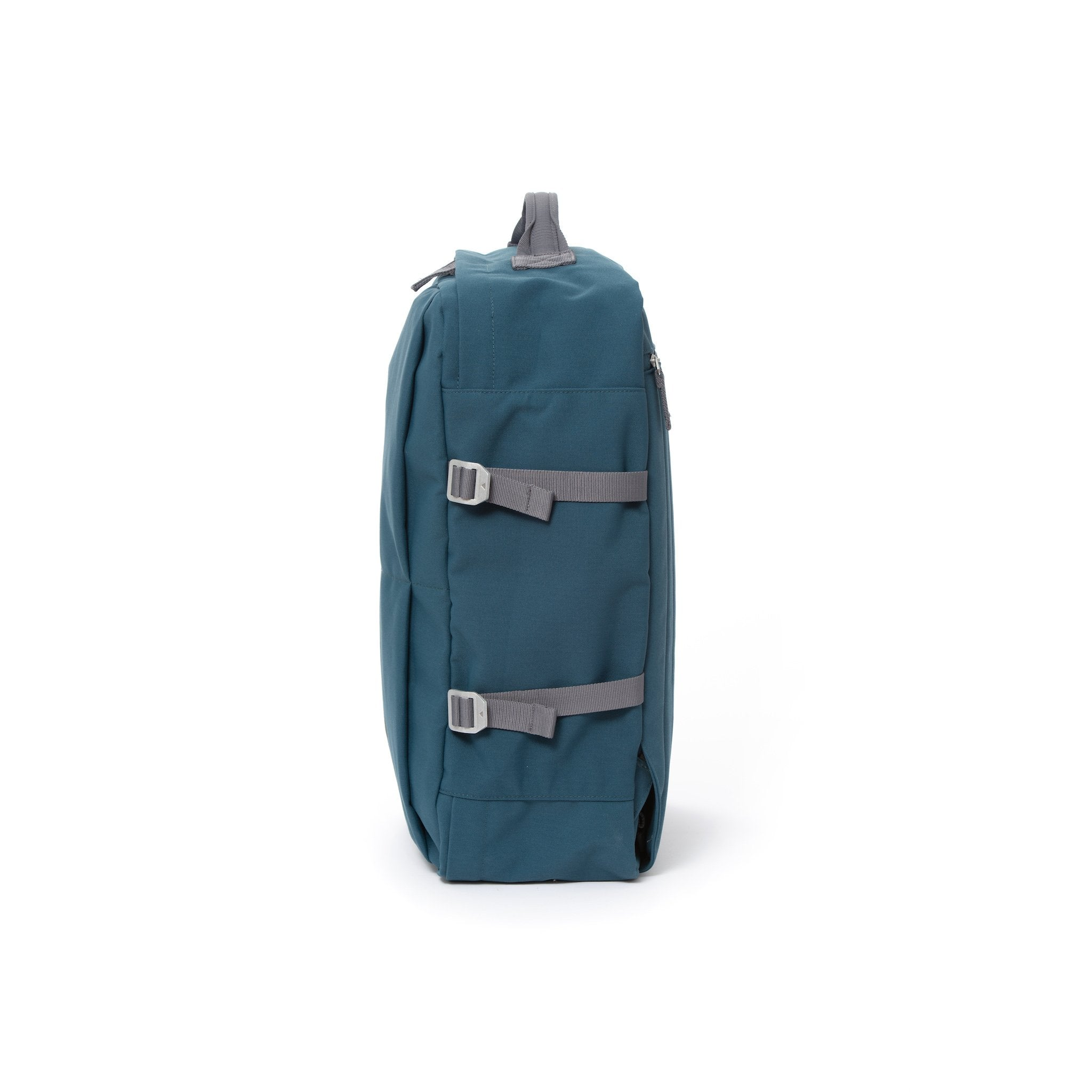 Blue waterproof canvas travel backpack with compression side straps.