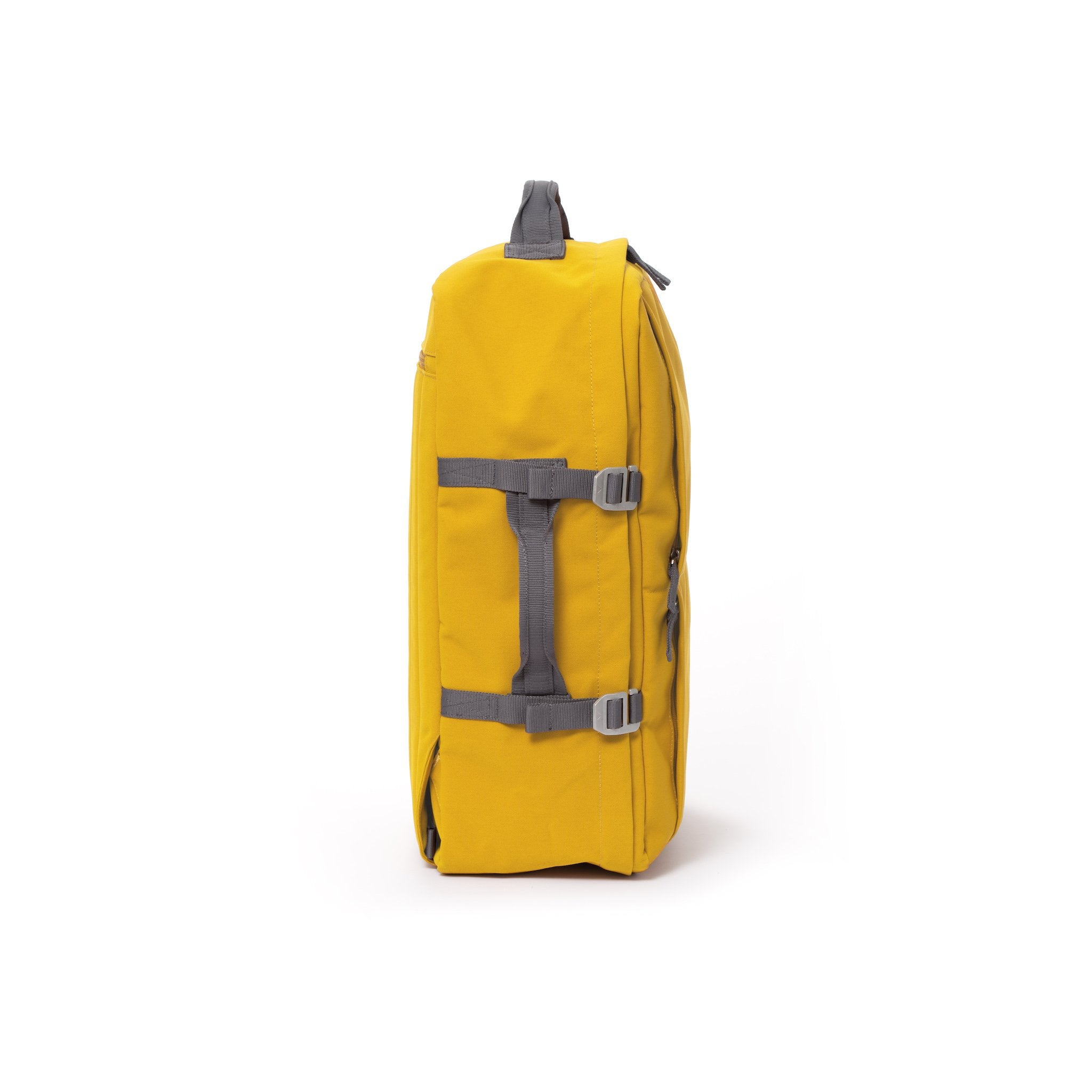 Yellow recycled canvas travel backpack with compression side straps.