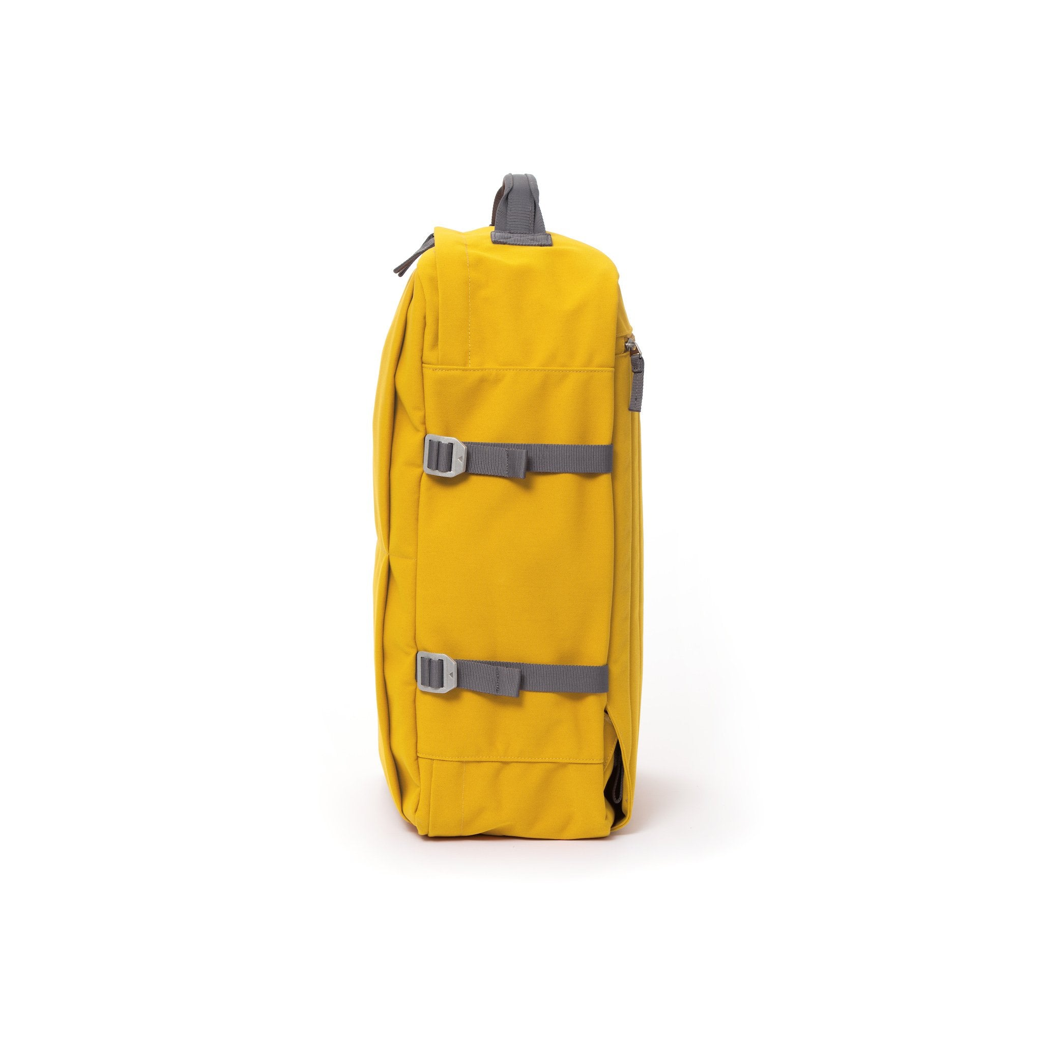 Yellow waterproof canvas travel backpack with compression side straps.