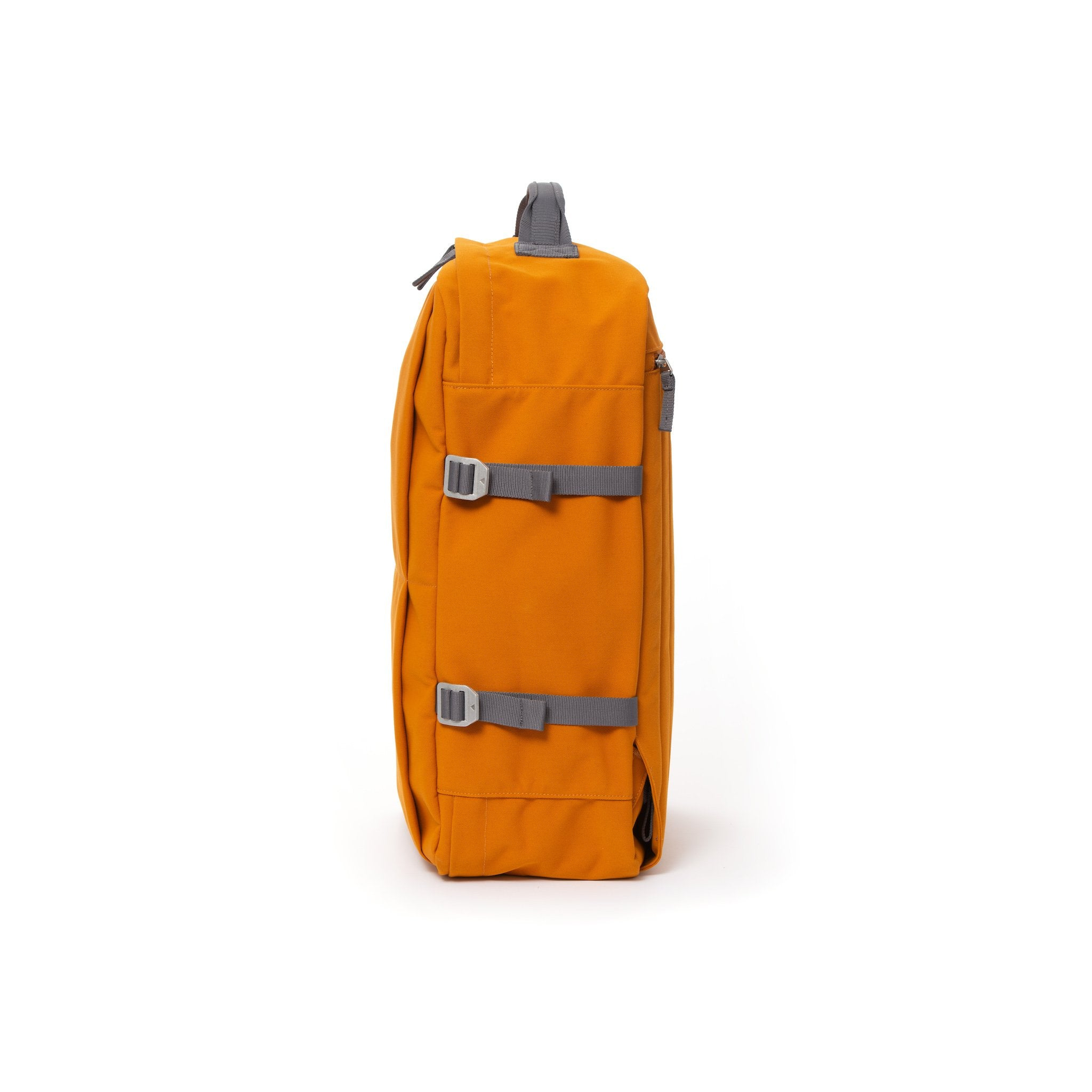 Orange waterproof canvas travel backpack with compression side straps.