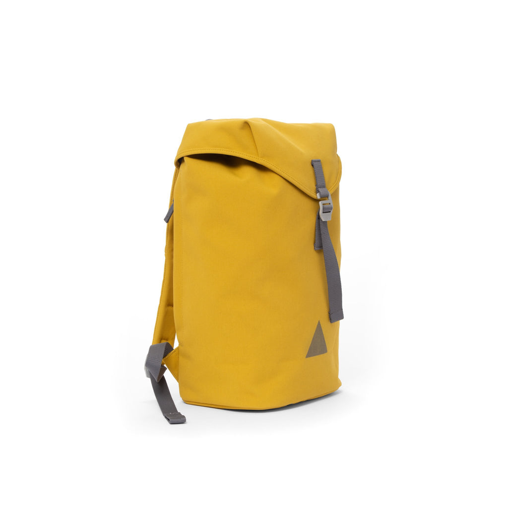 Yellow recycled canvas backpack with strap closure and metal buckle.
