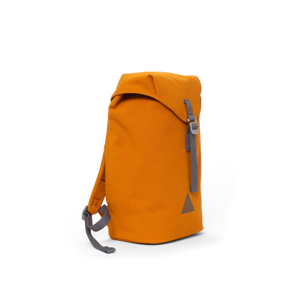 Orange recycled canvas backpack with strap closure and metal buckle.