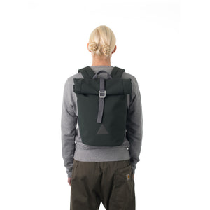 Woman carrying grey waterproof rolltop backpack.