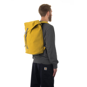 Man carrying yellow flap backpack.