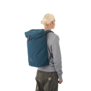 Woman wearing large blue backpack.