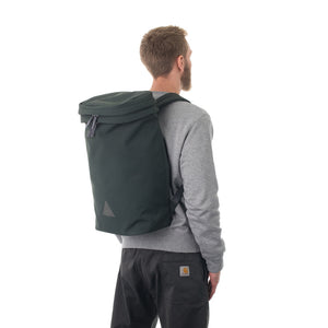 Man wearing large grey canvas backpack.