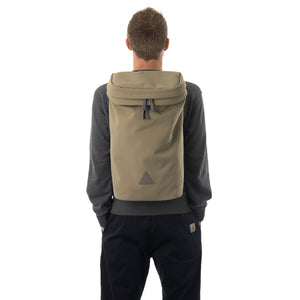 Man wearing large khaki backpack with triangle logo.