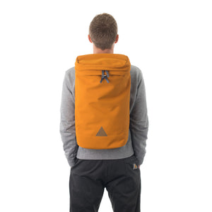 Man wearing large orange backpack with triangle logo.