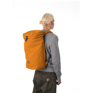 Woman wearing large orange backpack.