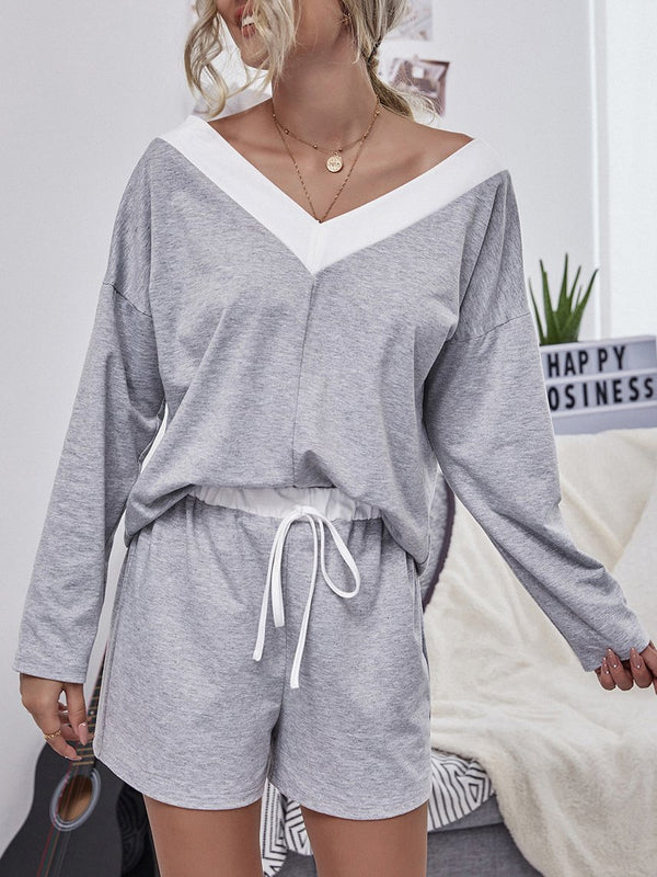 V neck loose plian top and belted shorts  two piece suit
