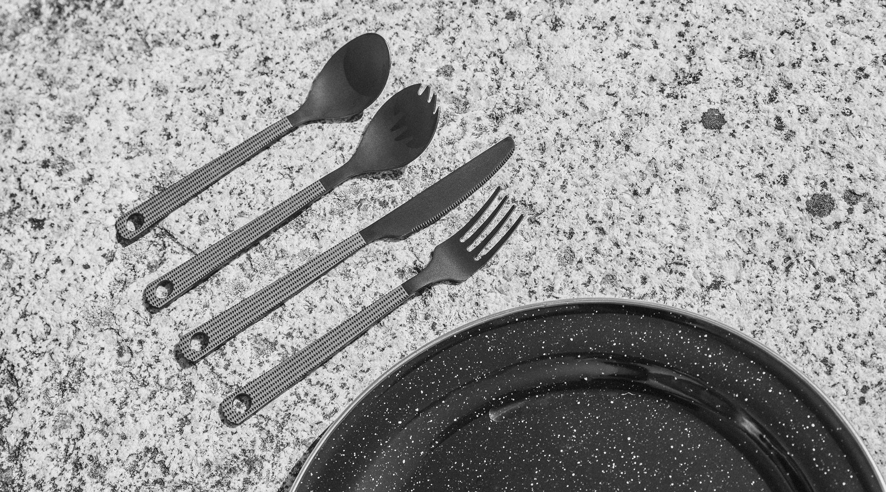 so ill x on the roam cutlery set shown on climbing rock with a plate