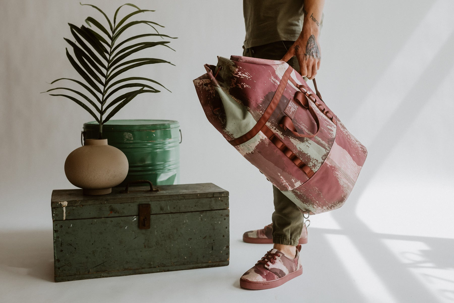 So iLL x On The Roam eco camo mini dirt bag is shown in a studio setting with a grey background