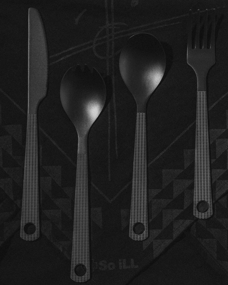 the so ill x on the roam cutlery set is shown with climbing equipment