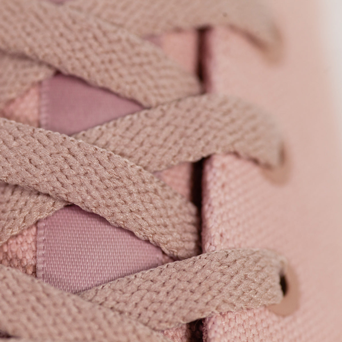 Close up of Dirty Pink Wino shoe laces and shoe tongue tab
